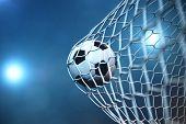 3d Rendering Soccer Ball In Goal. Soccer Ball In Net With Spotlight Or Stadium Light Background. Suc poster