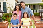 stock photo of neat  - Hispanic family outside home - JPG