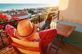 Young Man Relax On Scenic Balcony Terrace, Comfort, Laziness Concept poster