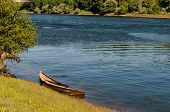 stock photo of minos  - Very old and damaged wooden boat at the river Mino side - JPG