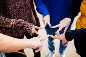 Group of friends using fingers to form the star shape teamwork and support concept poster