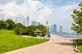 Park Walkway Of Lake Michigan With Chicago Skyline In The Background, Usa poster