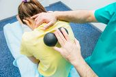 Woman At The Physiotherapy Receiving Ball Massage From Therapist. A Chiropractor Treats Patients Th poster