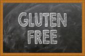 Gluten Free Written In Chalkboard. Conceptual Image With Word Gluten Free. Photo Stock. poster