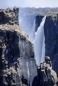 Постер, плакат: Tourist At The Victoria Falls World Nature Heritage Livingstone Zambia Victoria Falls National P