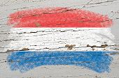 Flag Of Netherlands On Grunge Wooden Texture Painted With Chalk