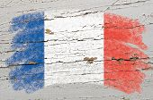 Flag Of France On Grunge Wooden Texture Painted With Chalk