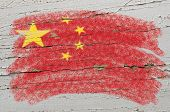 Flag Of China On Grunge Wooden Texture Painted With Chalk