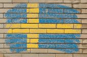 Flag Of Sweden On Grunge Brick Wall Painted With Chalk