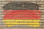 Flag Of Germany On Grunge Brick Wall Painted With Chalk