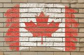 Flag Of Canada On Grunge Brick Wall Painted With Chalk