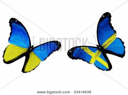 Concept - Two Butterflies With Ukrainian And Swedish Flags Flying
