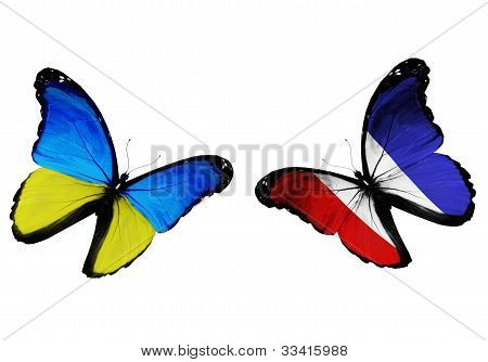 Concept - Two Butterflies With Ukrainian And French Flags Flying