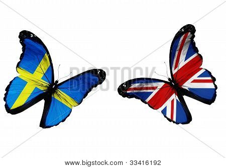 Concept - Two Butterflies With Swedish And English Flags Flying