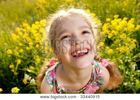 Portrait Of A Cheerful Little Girl