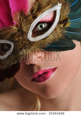 Beautiful Woman in Costume Mask
