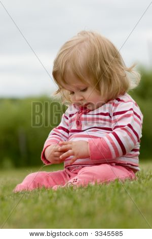 Little Girl In The Grass