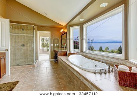 Large Bath Tun With Water View And Luxury Bathroom Interior.