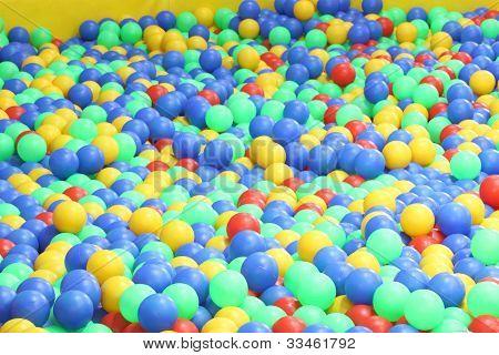 Plastic balls in play area of children.
