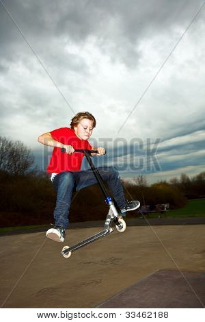 Boy Going Airborne With A Scooter