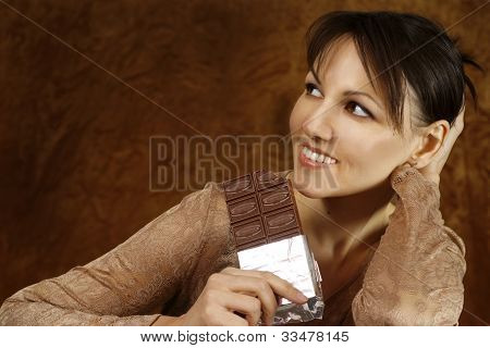 Young Caucasian Beautiful Woman With Chocolate