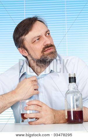 Problems Business Man Sitting At A Table With A Bottle