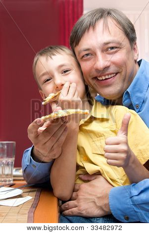 Man And Son With Pizza
