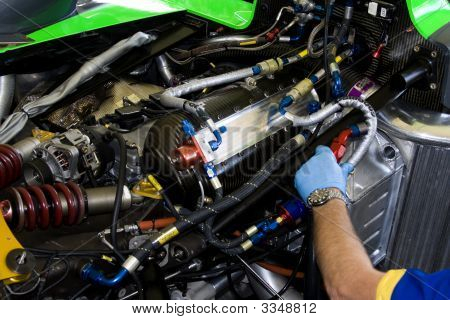 Mechanic Working On Racing Car Engine