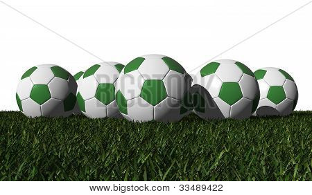 Green Soccer Balls On A Green Grass