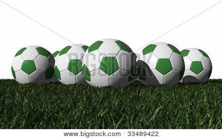 Green Soccer Balls On A Green Grass