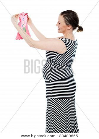 Pregnant Woman Looking At Baby Cloth, Rejoicing