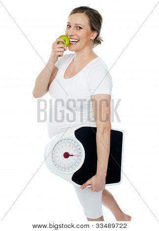 Young Pregnant Woman Enjoy Fresh Green Apple