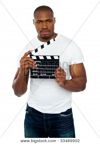 Masculine African Male Holding Clapperboard
