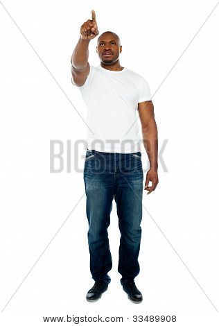 African Male Pointing His Finger At Copyspace