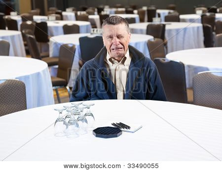 Man Crying In Empty Conference Room