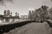Central Park winter with skyscrapers and Bow Bridge in midtown Manhattan New York City poster