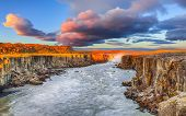 Dramatic Sunset View Of Fantastic Waterfall And Cascades Of Selfoss Waterfall. Location: Vatnajokull poster