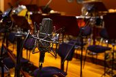 Microphone With A Stand Close Up. Musical Instruments Of The Orchestra In Philharmonia. poster
