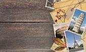 Vintage travel background with old wood planks texture, retro photos of european landmarks, envelope poster