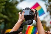 Correspondent Takes Photo During The Gay Pride Parade poster