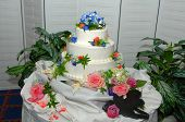 picture of three tier  - Wedding cake with three tiers on a table at a wedding reception - JPG