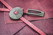 Pink Vintage Leather Belt With Decorative Metal Fittings On The Samples Of Fashion Genuine Leather B poster