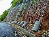 Wire Net Placed On A Rocky Hill As Prevention From Rocks Falling On The Road And Preventing Accident poster
