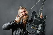 Music Party. Handsome Rock Star In Leather Jacket. Music Concept. Bearded Man With Electric Guitar.  poster