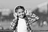 Adorable Music Lover. Little Kid Enjoy Listening To Music. Little Girl Wearing Stereo Headphones. Li poster