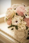 Bouquet Of Flowers In A Beautiful Box On A White Piano. Bouquet Of Asters, Hydrangeas And Daisies. B poster