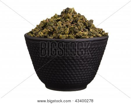 Metal Bowl With Chinese Dry Green Tea Leaves Isolated On White
