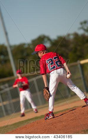 Little League Baseball Pitcher Looking At Batter.