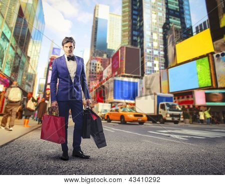 young guy with a lot of bags goes shopping in New York