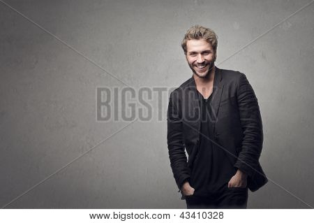 handsome man smiling on gray background